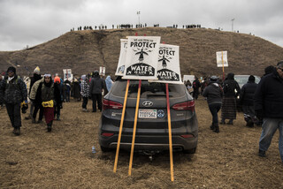 The art tent screen printed signs of solidarity, pictured here, used during direct action to remind both protectors and police that they are peaceful.